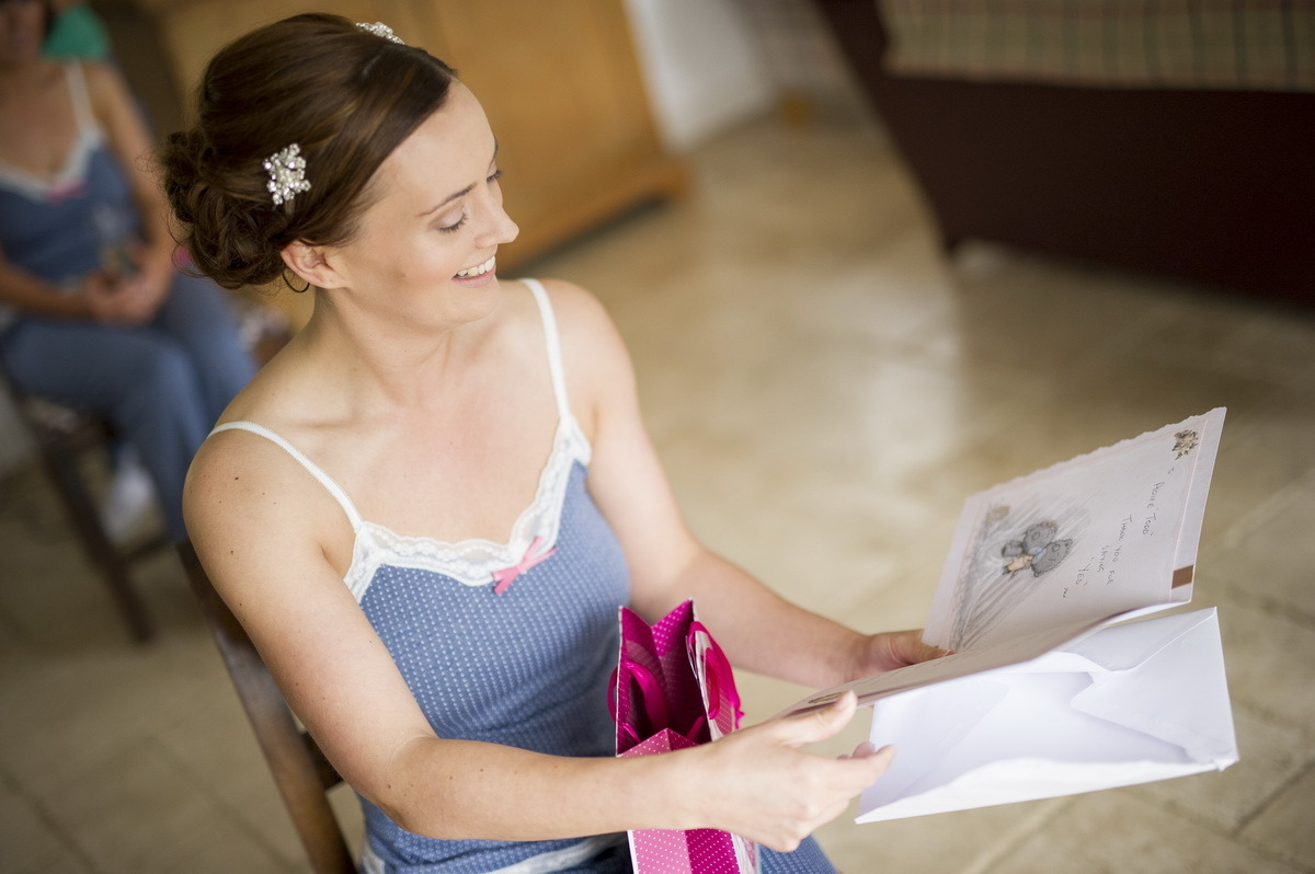 bride-reading-card-laughing.jpg