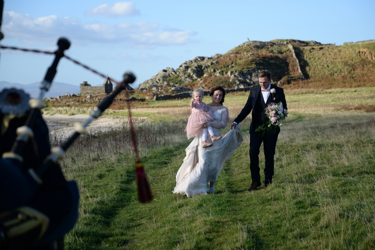 D-bride-groom-walking-family-piper-beach-grass.jpg