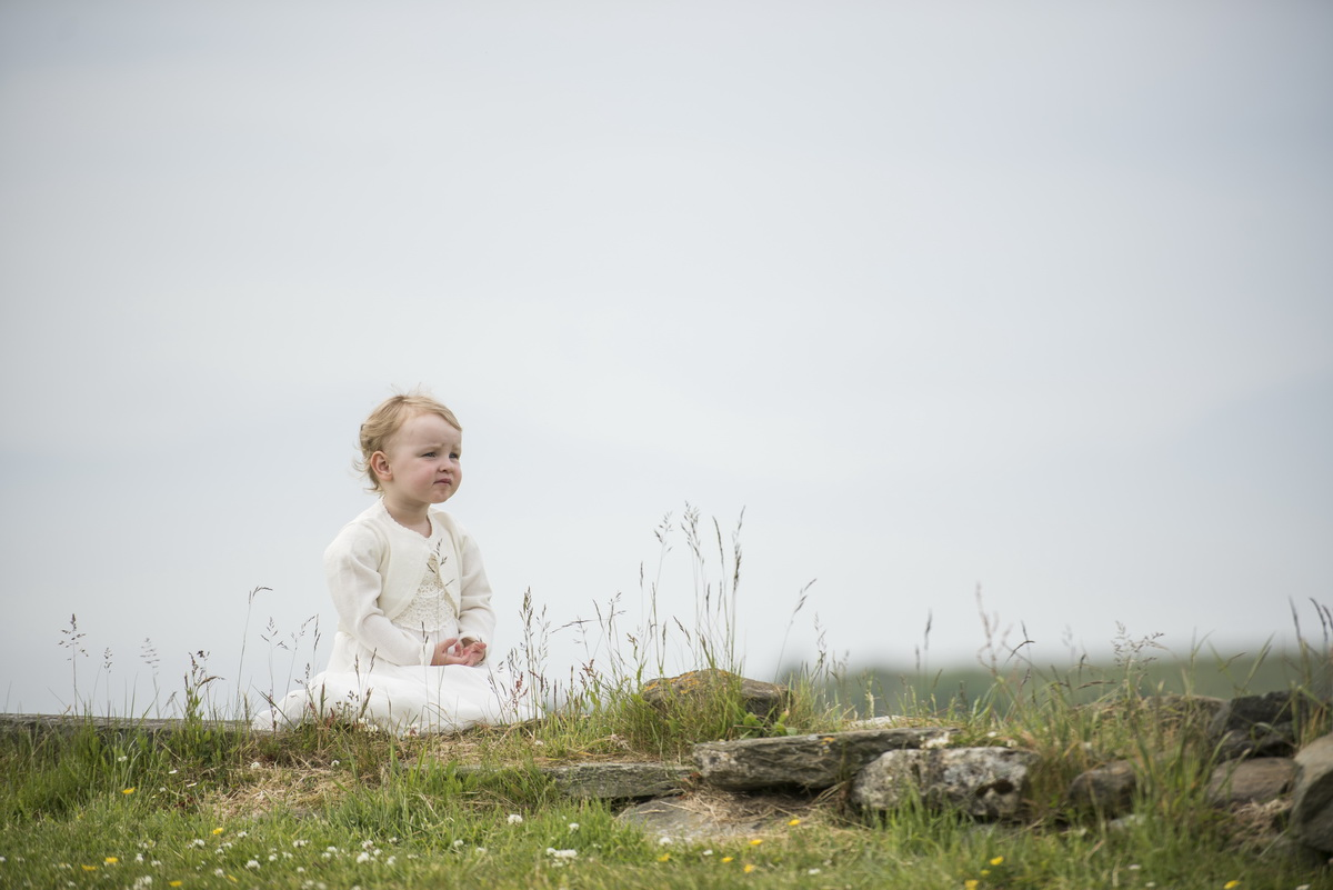 d-young-child-looking-out-crear-house-outside-in-grass.jpg
