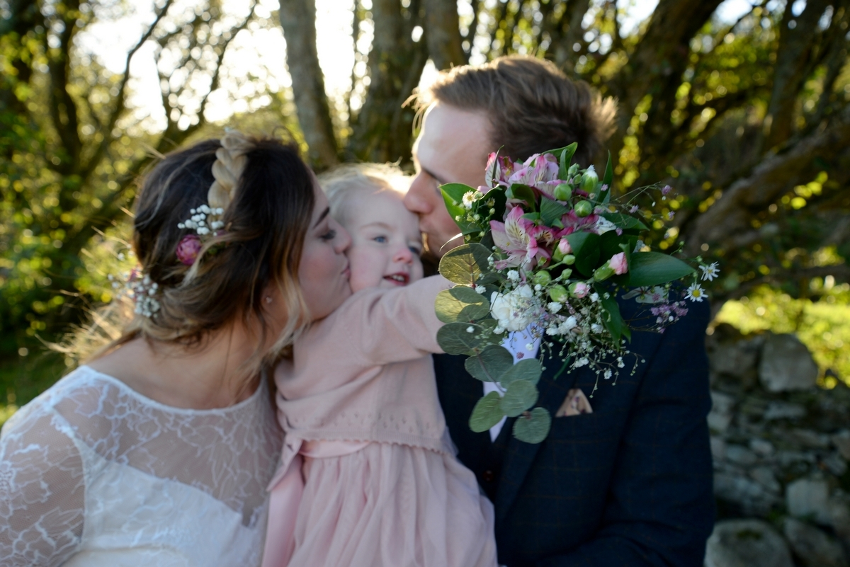 E-family-bride-groom-child-daughter-flowers.jpg