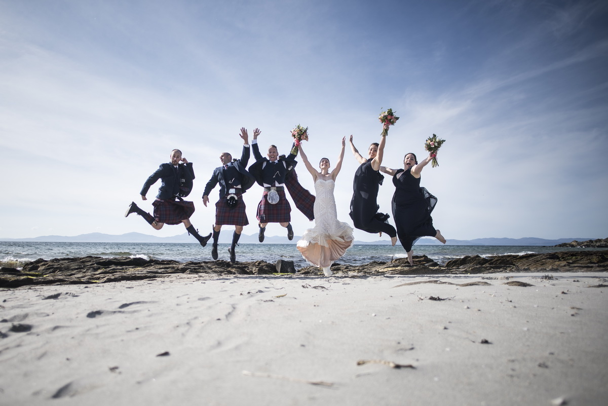 bouquets-beach-leaping-bridesmaids-bride-groom-bestman.jpg