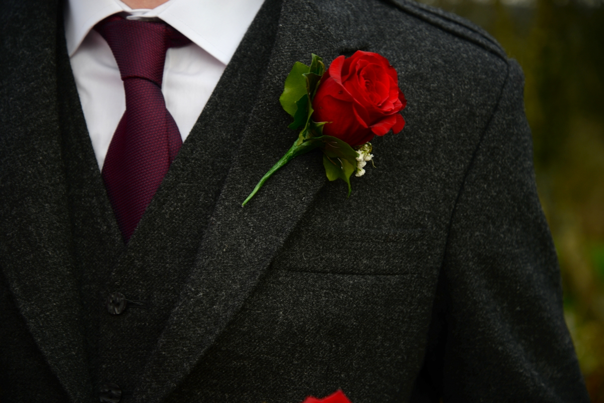 A-buttonhole-red-rose-suit-tie.jpg