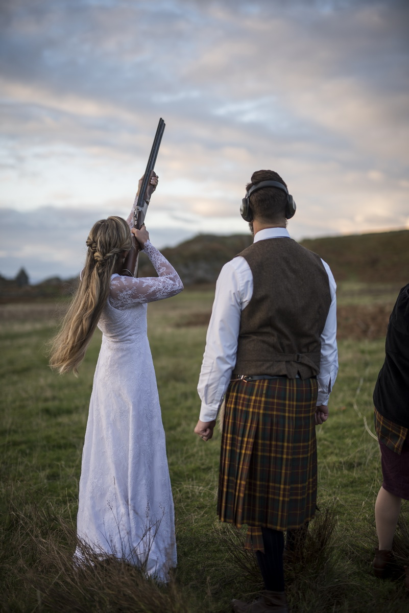 e-bride-clay-pigeon-shooting-groom-watching-sky.jpg