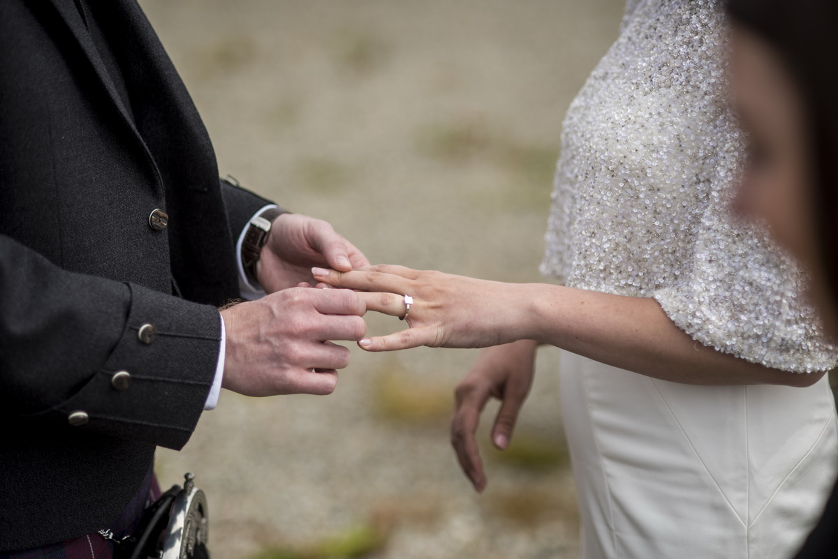 c-ceremony-exchanging-wedding-vows-rings-outside.jpg
