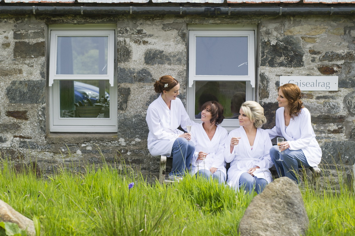 bridesmaids-chatting-outside-cottage-getting-ready.jpg