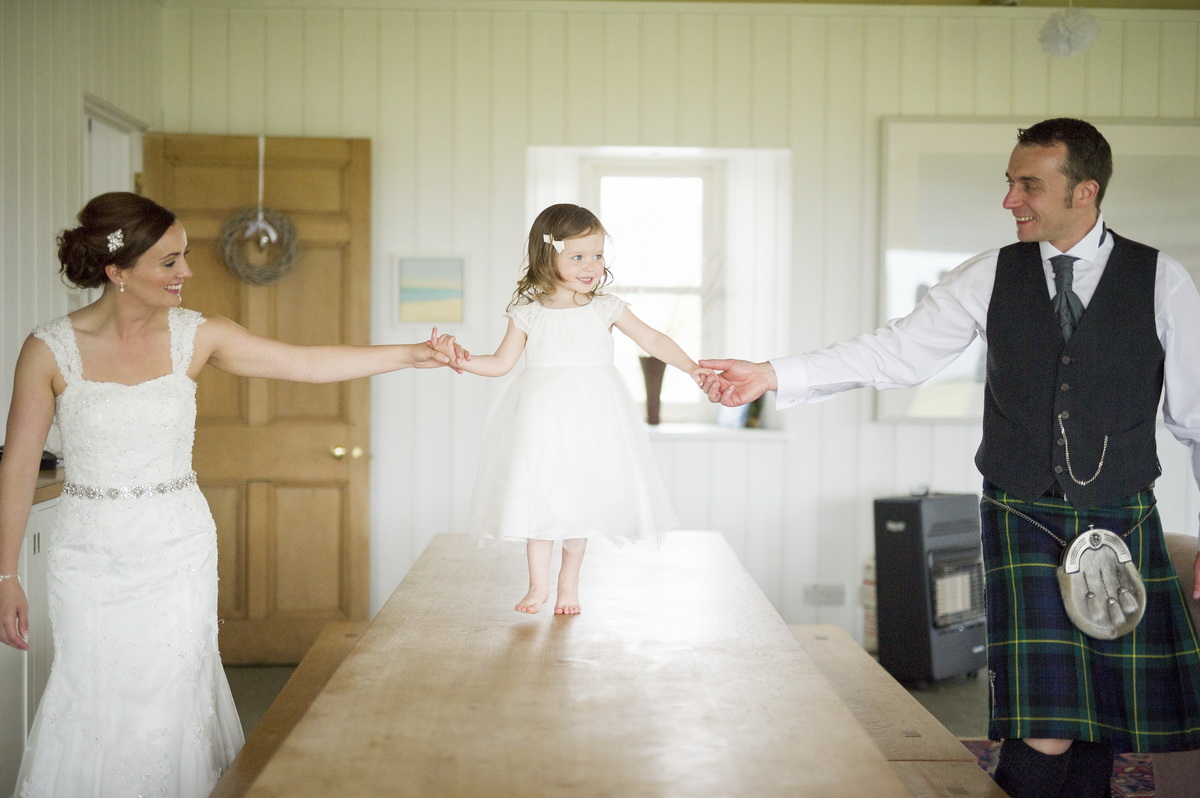 bride-groom-playing-with-child-happy.jpg