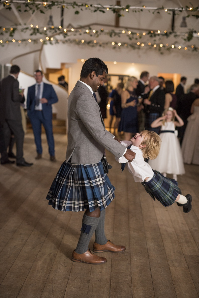 evening-guests-dancing-young-boy-kilts.jpg