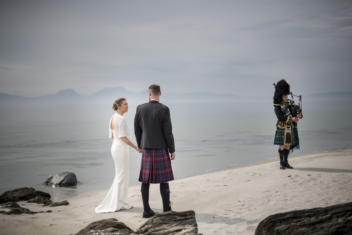 d-wedding-couple-walking-hand-and-hand-along-beach-piper.jpg