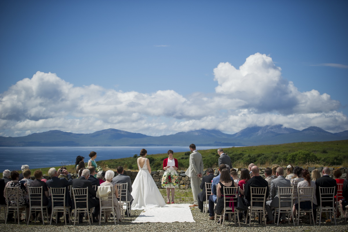 c-ceremony-bride-and-groom-outside-looking-out-to-jura-horizon-blue-sky.jpg