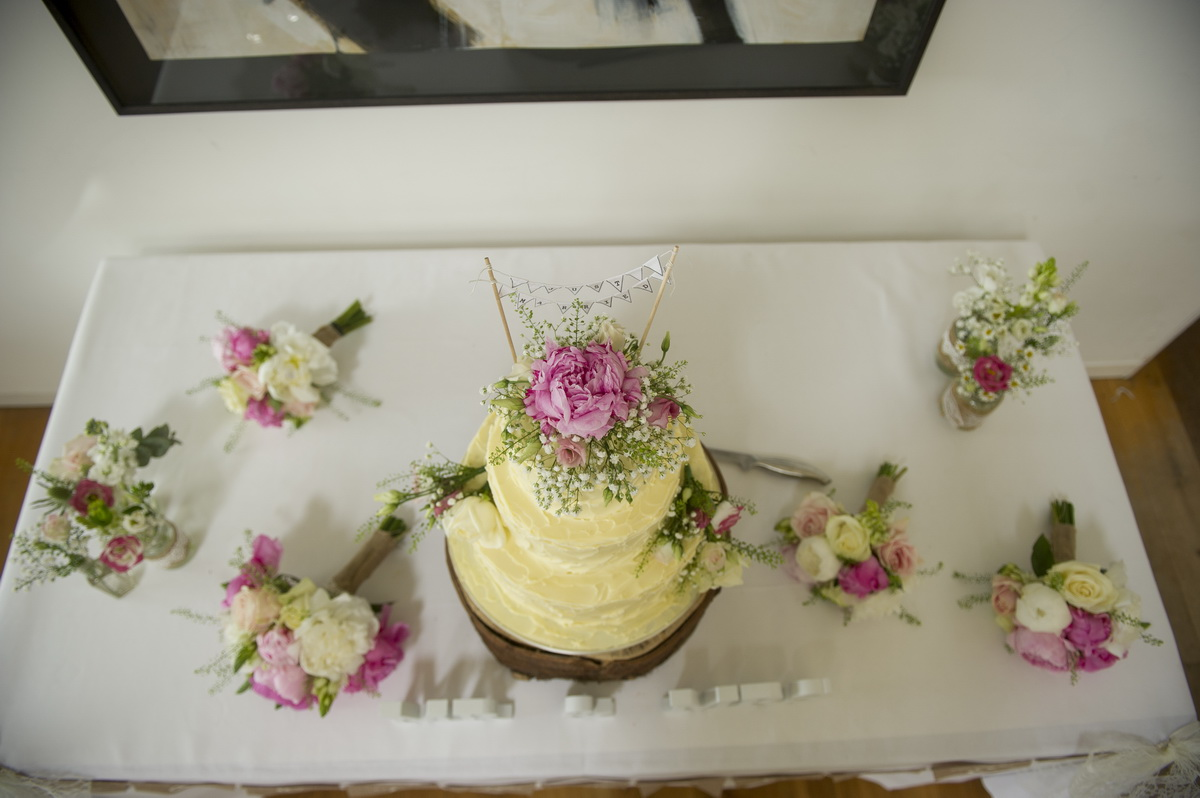 cake-shot-from-above-flowers-cream-pink-e.jpg