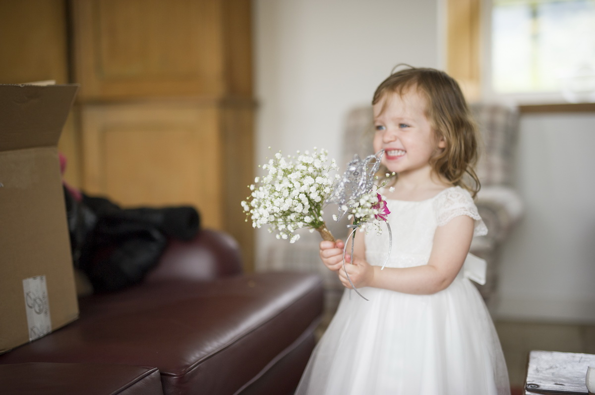 posy-white-child-flowers-wand-laughing-e.jpg