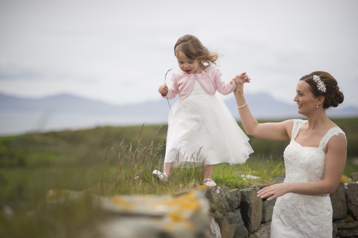 bride-with-child-helping-along-wall.jpg