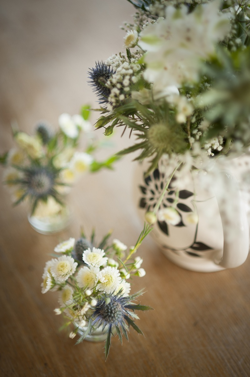 flowers-jug-button-holes-table-white-thistle-green.jpg