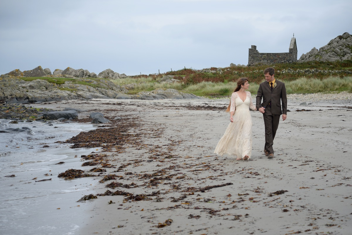 couple-walking-along-beach-hand-in-hand.JPG