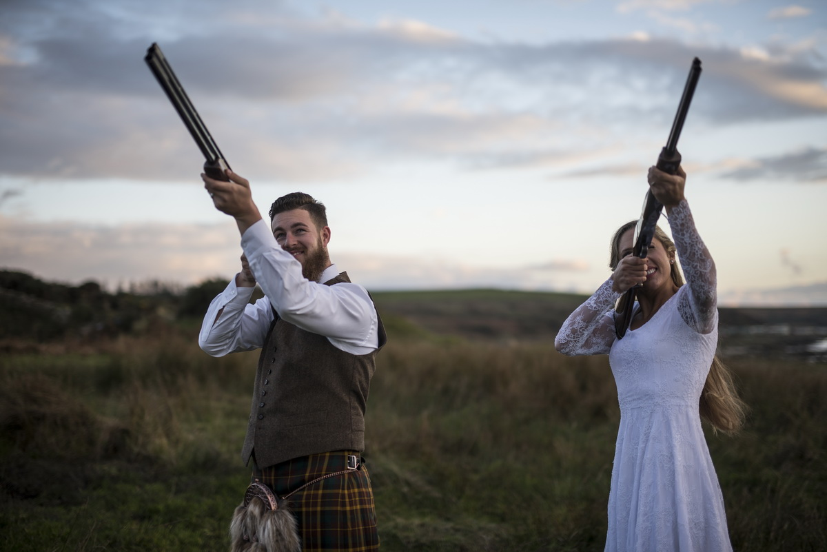 e-bride-groom-clay-pigeon-shooting-pionting-to-sky.jpg