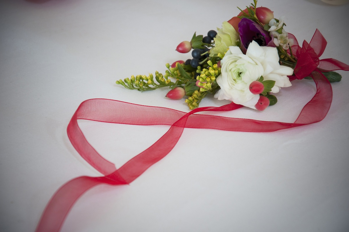 red-ribbon-white-green-flowers.jpg