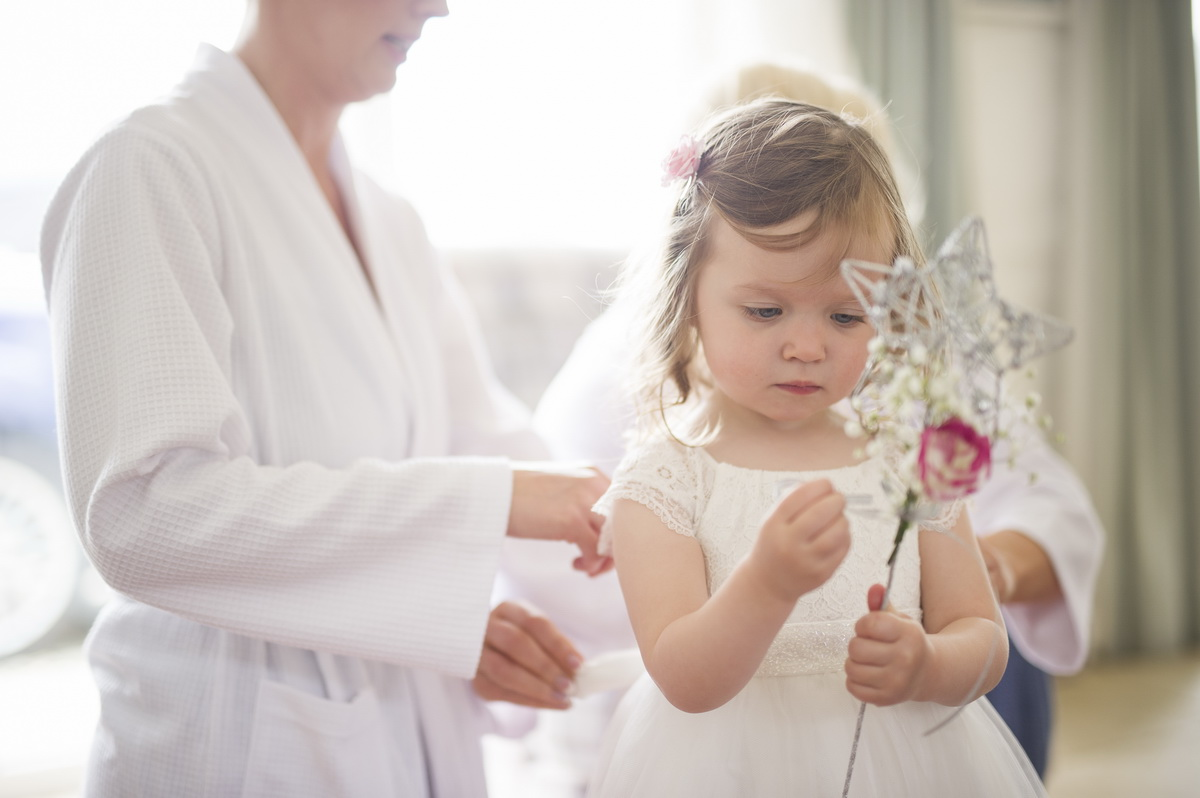 child-bridesmaid-fixing-star-wand-getting-ready.jpg