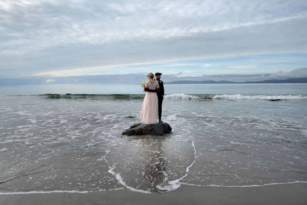 D-couple-bride-groom-married-sea-tide-beach-stranded.jpg