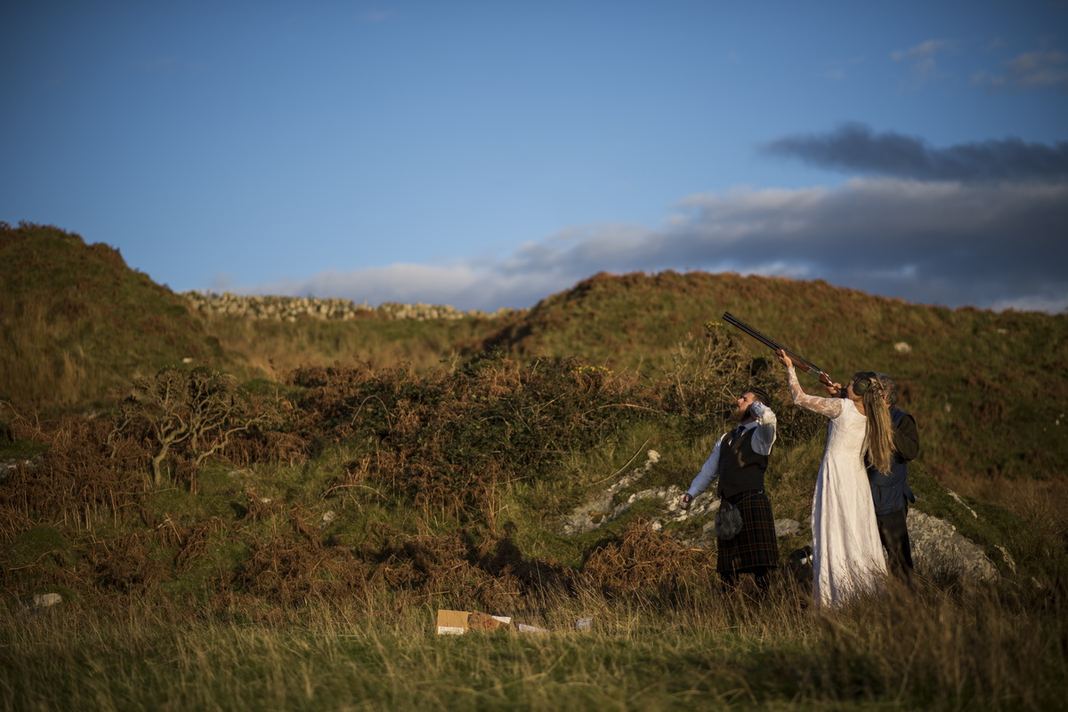 e-bride-clay-pigeon-shooting-groom-watching-landscape.jpg