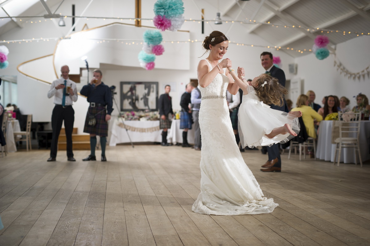bride-dancing-with-child-swinging-e.jpg