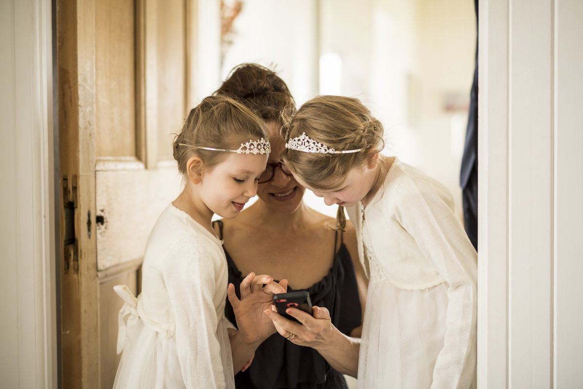 b-brides-maid-with-flower-girls-looking-at-wedding-ring-white.jpg