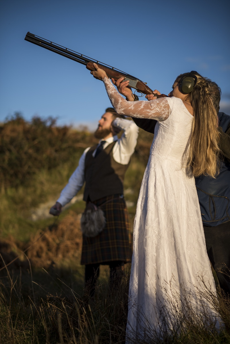 e-bride-clay-pigeon-shooting-groom-watching.jpg